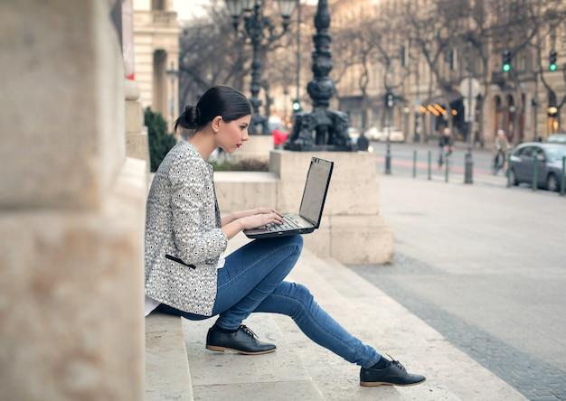 Pretty woman using a laptop