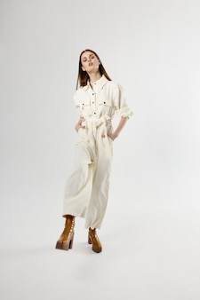 Pretty woman in white full length suit isolated fashion shoes