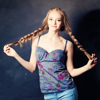 Pretty woman with braids on background