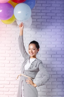 Pretty woman with colored balloons