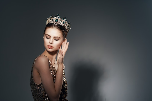 Pretty woman with crown on her head bright makeup luxury decoration