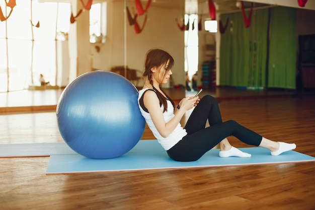 Pretty woman with fitball