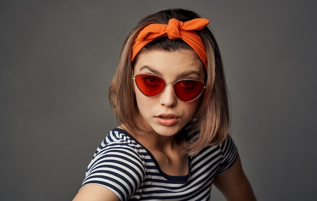 Pretty woman with glasses in a striped tshirt headband