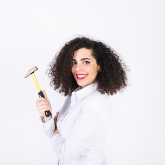 Pretty woman with hammer
