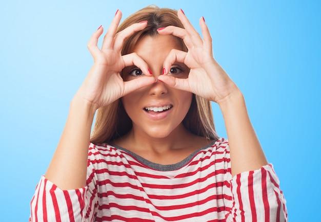Pretty woman with hand binoculars