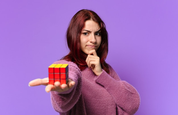 Pretty woman with a intelligence toy challenge