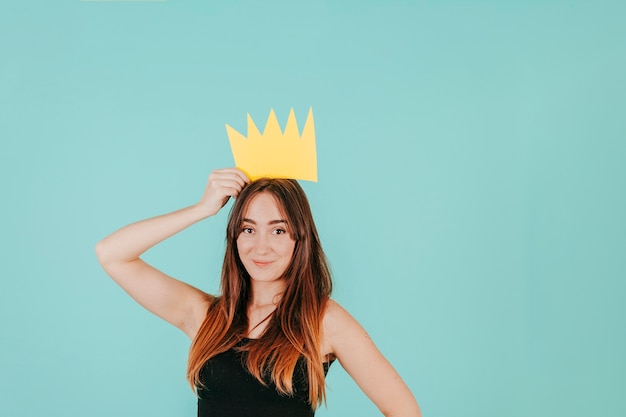 Pretty woman with paper crown