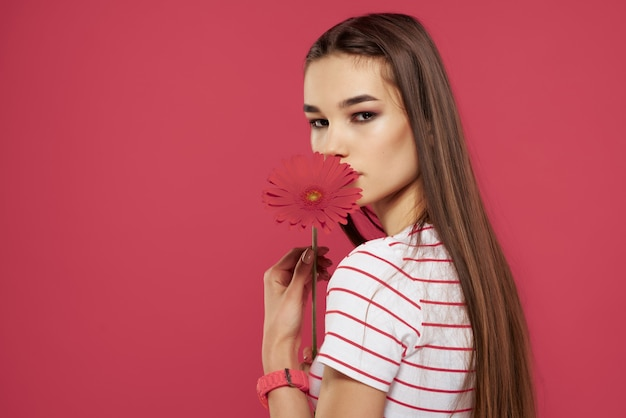 Pretty woman with red flower glamor model isolated background