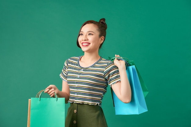 Pretty woman with shopping mall happiness packages