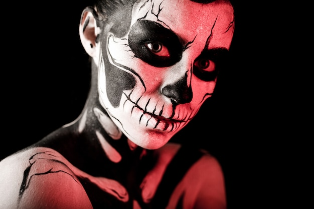 Pretty woman with skeleton paint