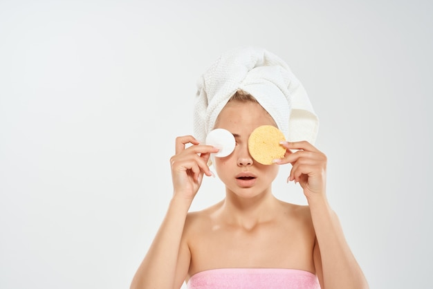 Pretty woman with towel on head health clean skin dermatology cleaning. high quality photo