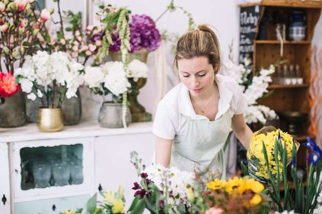 Pretty woman working in flower shop