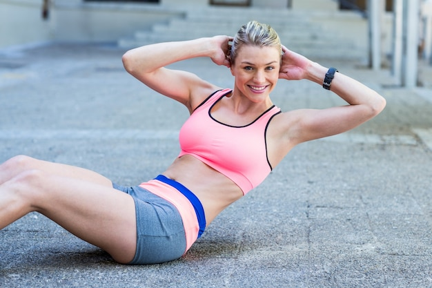 Pretty woman working on her abs