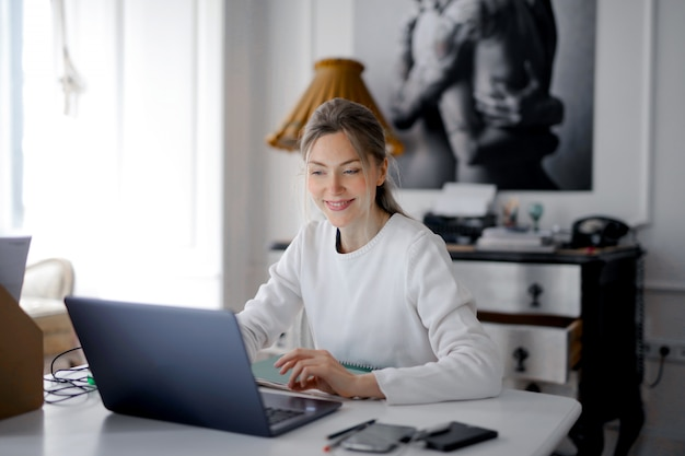 Pretty woman working on a laptop