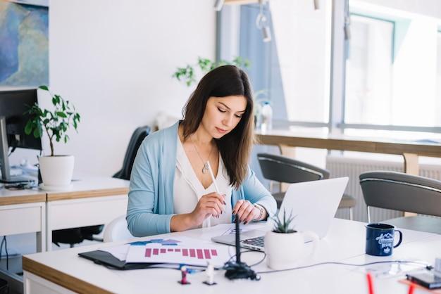 Pretty woman working in office