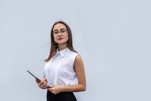 Pretty young businesswoman with digital tablet computer isolated on white background
