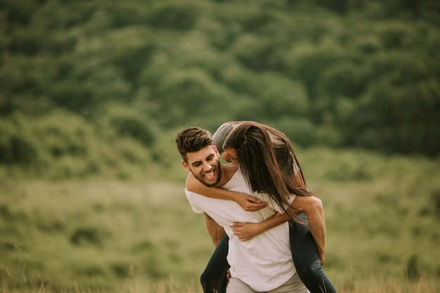 Pretty young couple in love outside in spring nature