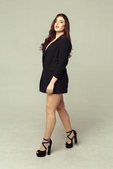 Pretty young fashion sensual woman posing