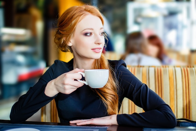 Pretty young girl in cafe.