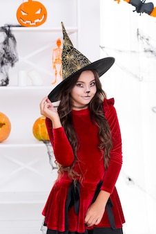 Pretty young girl posing in halloween costume