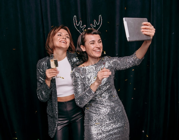 Pretty young girls taking a selfie