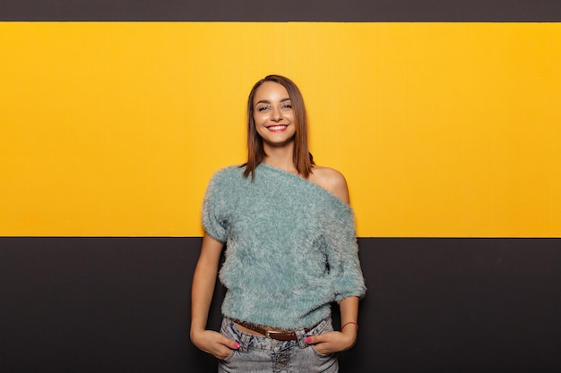 Pretty young lady fooling around in studio