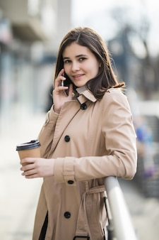 Pretty young lady with short hair talking on phone with somebody