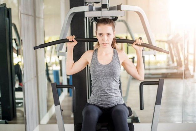 Pretty young sport woman is workout in gym, healthy lifestyle