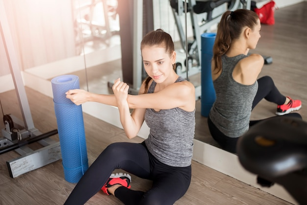 Pretty young sporty woman is warm up in gym, healthy lifestyle