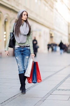 Pretty young woman in christmas shopping