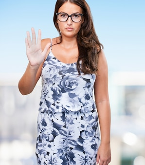 Pretty young woman doing a stop gesture
