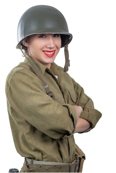 Pretty young woman dressed in american ww2 military uniform with m1 helmet