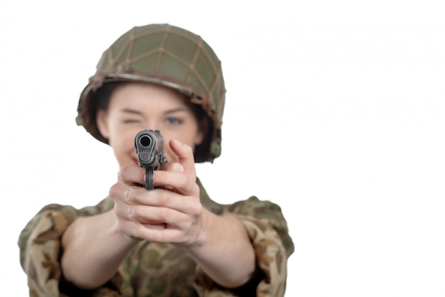 Pretty young woman dressed in ww2 american military uniform with handgun