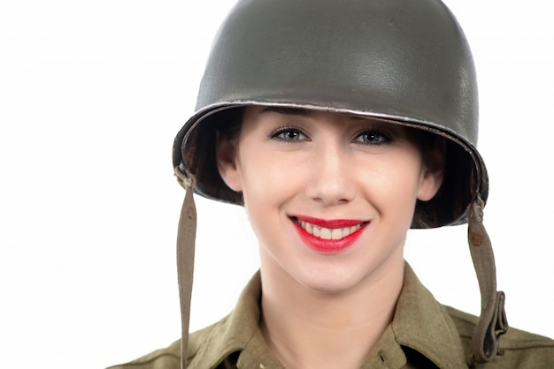 A pretty young woman dressed in wwii military uniform with helmet