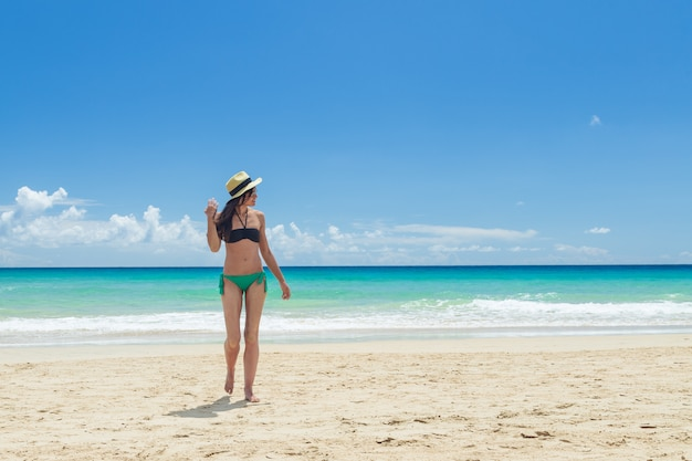 Pretty young woman, enjoying on the beach in fuerteventura, canary islands, spain.