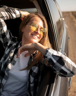 Pretty young woman enjoying road trip
