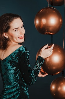 Pretty young woman in a green velvet dress, new year, christmas holiday concept