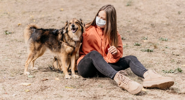 Pretty young woman petting her dog