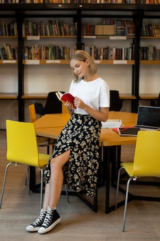Pretty young woman reading a book