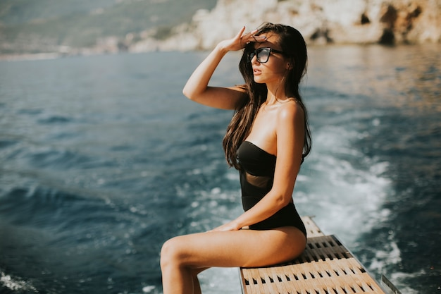 Pretty young woman relaxing on the yacht