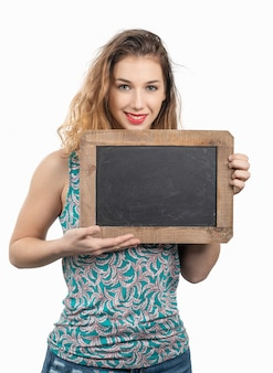 Pretty young woman showing a small chalkboard on white background