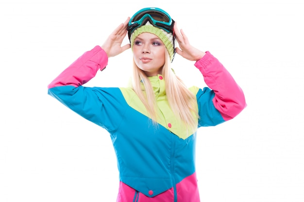 Pretty young woman in ski outfit and ski glasses