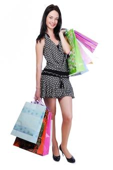 かなり若い女性立っている色のバッグと白で隔離