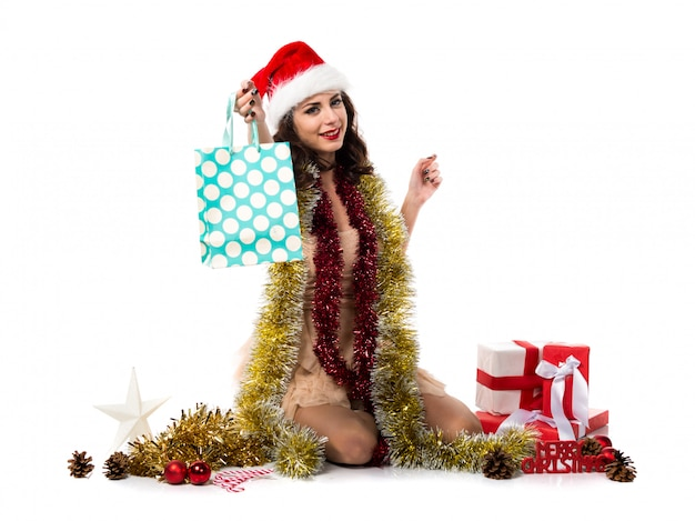 Pretty young woman with many shopping bags. christmas concept
