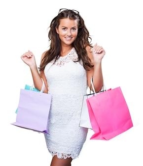 쇼핑백과 예쁜 젊은 여자