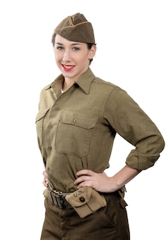 A pretty young woman in wwii uniform us with garrison cap on white