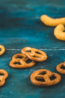 Pretzel crackers and snacks on blue table