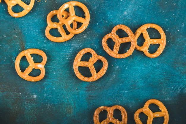 Pretzel crackers on a wooden blue background