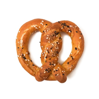 Pretzel with salt and sesame seeds isolated on white background
