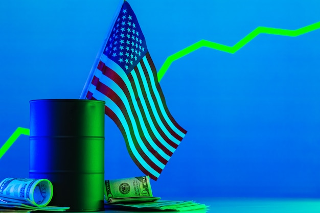 Price of american oil is changing concept. black barrel with oil and graph